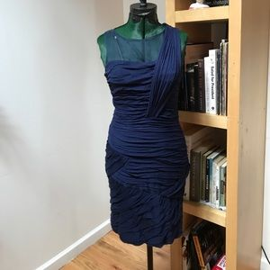 Navy cocktail dress with sheer neckline